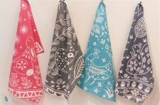 4 Tea towels hanging up